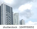 modern residential high rise... | Shutterstock . vector #1049950052