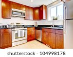 Stock photo modern new cherry kitchen with steal appliances 104998178
