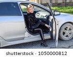 the girl opens the door in the... | Shutterstock . vector #1050000812