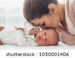 home portrait of a newborn baby ... | Shutterstock . vector #1050001406