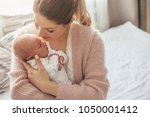 home portrait of a newborn baby ... | Shutterstock . vector #1050001412