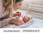home portrait of a newborn baby ... | Shutterstock . vector #1050001415