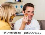 swedish girl face painting... | Shutterstock . vector #1050004112