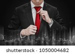 businessman tying red necktie... | Shutterstock . vector #1050004682