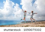 two young girls traveler... | Shutterstock . vector #1050075332