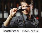 bokal of red wine on background ...   Shutterstock . vector #1050079412