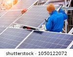 technicians in blue suits... | Shutterstock . vector #1050122072