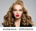 beautiful young blond girl with ... | Shutterstock . vector #1050136226