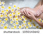woman legs in bath tube with... | Shutterstock . vector #1050143642