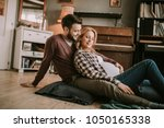 pregnant woman with a husband... | Shutterstock . vector #1050165338