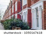 typical row of terraced brick... | Shutterstock . vector #1050167618