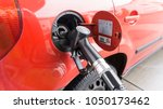 diesel car with gas pump nozzle.... | Shutterstock . vector #1050173462
