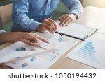 confident business leader ... | Shutterstock . vector #1050194432