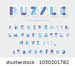puzzle paper cut out font in... | Shutterstock .eps vector #1050201782