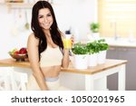 fit smiling young woman with... | Shutterstock . vector #1050201965