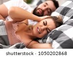 adult couple suffering from... | Shutterstock . vector #1050202868