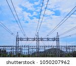 high steel pole and many power... | Shutterstock . vector #1050207962