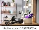 hairdresser tools on table in...   Shutterstock . vector #1050209936