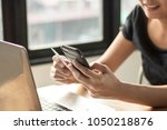 people use notebook and holding ... | Shutterstock . vector #1050218876