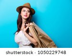 young girl in hat with shopping ...   Shutterstock . vector #1050229748