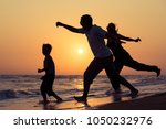 father mother and son  playing... | Shutterstock . vector #1050232976