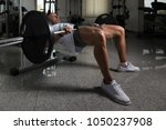 strong man in the gym... | Shutterstock . vector #1050237908