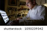 man surfing the web with laptop ... | Shutterstock . vector #1050239342