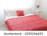 red merino wool blanket or... | Shutterstock . vector #1050246692