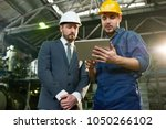 portrait of young factory... | Shutterstock . vector #1050266102