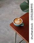 a cup of coffee latte with... | Shutterstock . vector #1050288995