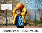 cute little boy holding a... | Shutterstock . vector #1050296006