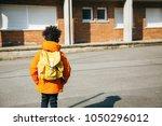 little school boy in orange... | Shutterstock . vector #1050296012