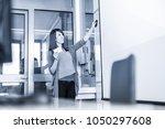 female speaker giving... | Shutterstock . vector #1050297608