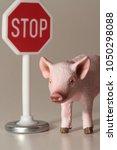 stop eating pigs miniatures... | Shutterstock . vector #1050298088