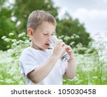 child drinking pure water in... | Shutterstock . vector #105030458