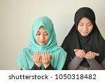 happy peaceful muslim women... | Shutterstock . vector #1050318482