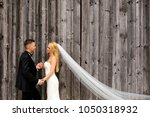 wedding couple posing in front... | Shutterstock . vector #1050318932