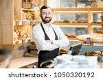 portrait of a handsome seller... | Shutterstock . vector #1050320192