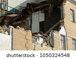 an abandoned house collapses in ... | Shutterstock . vector #1050324548