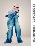 caucasian boy wearing his dad's ... | Shutterstock . vector #1050330368