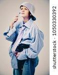 caucasian boy wearing his dad's ... | Shutterstock . vector #1050330392
