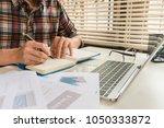 businessman writing on notebook ... | Shutterstock . vector #1050333872