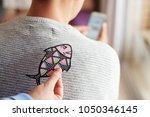 a young caucasian man seen from ... | Shutterstock . vector #1050346145