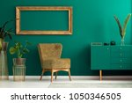 palm leaf on a modern  teal... | Shutterstock . vector #1050346505