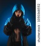 girl boxer in a sweatshirt with ...   Shutterstock . vector #1050368552
