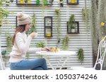 asian young women wearing... | Shutterstock . vector #1050374246