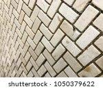 stone brick wall textured...   Shutterstock . vector #1050379622