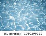 texture of water in swimming... | Shutterstock . vector #1050399332