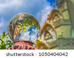 reflections of a thai temple in ... | Shutterstock . vector #1050404042