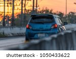 blurry cars on the road at... | Shutterstock . vector #1050433622